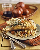 A Roasted Turkey Leg with Lentils and Bread