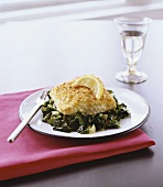 Breaded Halibut Fillet on a Bed of Greens