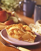 A slice of caramel walnut apple pie