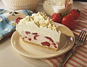 A slice of strawberry cream pie