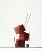 Cubes of watermelon in a glass