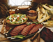 Ranch style buffet, with ribs, salad, baked beans, pie and iced tea