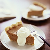 Two Slices of Squash Pie with Whipped Cream
