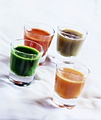 Four shots of vegetable juice