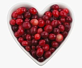Overhead of Cranberries in a Heart Shaped Bowl; White Background