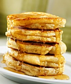 A Stack of Fluffy Pancakes with Maple Syrup