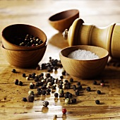 Peppercorns and Salt with Grinder and Wooden Bowls