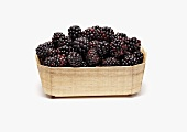 Wooden Basket Full of Fresh Blackberries on White Background