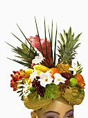 Woman Wearing Hat Made of Fresh Flowers and Fruit; White Background