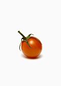 Single Cherry Tomato on White Background