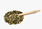 Pile of Wasabi Furikake with Wooden Spoon on White Background