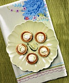 Overhead of Mini Key Lime Pies on Green Plate; Lime Slice Garnish