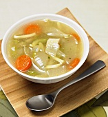 Bowl of Chicken Noodle Soup with Spoon