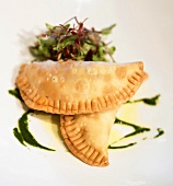 Two Empanadas with Mesclun Greens