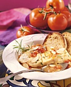 Cod steak with almonds and tomato sauce