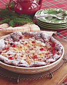 Apple pie with cocktail cherries and almonds