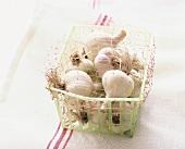 Garlic in small plastic basket