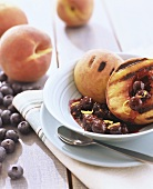 Grilled peach with blueberry compote