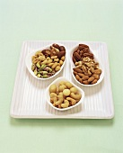 Three Small Bowls of Assorted Nuts
