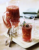 Gazpacho Served in Tall Glass Mugs Garnished with Red Onion; Pitcher of Gazpacho