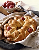 Loaf of Greek Easter Egg Bread; Bowl of Red Eggs