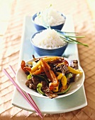 Platter with Bowl of Beef and Bell Pepper Stir Fry and Two Bowls of Rice; Chopsticks