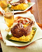 Chicken Tandoori on a Bed of Yellow Rice on Square Green Plate; Beverage