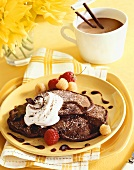 Chocolate Pancakes on a Plate with Whipped Cream and Red and Golden Raspberries
