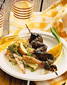 Grilled Beef on a Skewer with Red Potatoes and Rosemary on a Plate