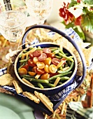 Bowl of Red and Yellow Tomatoes with Green and Yellow Bean Salad; Bread Triangles