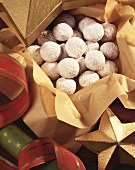 Holiday Snowball Cookies on Gold Paper in a Gold Holiday Box; Christmas Ribbon