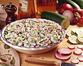Large Bowl of Cucumber, Radish and Red Onion Salad with Sour Cream Dressing; Fresh Ingredients