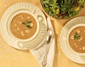 Overhead of Two Bowls of Shrimp Bisque; Salad