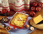 Vermont Cheddar Apple Bake in Rectangle Baking Dish with Apple Slice Garnish; Fresh Ingredients