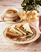 Plate with Assorted Tea Sandwiches; Radish Garnish and Cup of Tea with Lemon