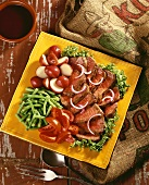 Steak Salad; Sliced Steak Over Lettuce with Tomatoes, Green Beans, Red Potatoes and Onion Slices
