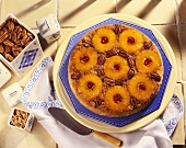 Pineapple Upside Down Cake with Pecans; Pie Server and Canister of Pecans