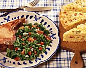 Pork Chop with Fried Greens with Red Bell Pepper and Bacon; Corn Bread
