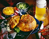 Chili in Bread Bowl with Mug of Beer