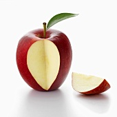A red apple with a piece cut out