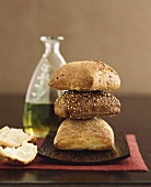 Three Loaves of Bread, Stacked, with a Bottle of Olive Oil