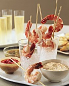 Skewered Cooked Shrimp on Ice with Various Dips