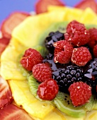 Fruit salad of berries, kiwi fruit and pineapple