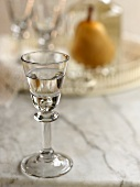 Pear Brandy in Shot Glass; Tray with Glasses, Decanter, and Pear