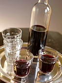 Red Wine in Bottle and Glasses on Silver Tray