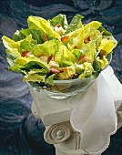 Caesar Salad in Large Glass Bowl on White Pillar