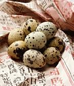 A Pile of Fresh Quail Eggs on Asian Newspaper