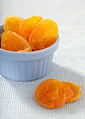 Dried Apricots in and Beside a Blue Glass Bowl