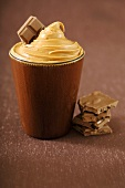Brown Cup Filled with Peanut Butter with Milk Chocolate Chunks