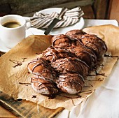 Chocolate yeast plait and cup of coffee